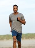 Healthy young black man running outdoors Royalty Free Stock Photography