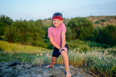 Healthy young boy doing exercises Stock Image