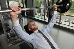 Healthy Young Businessman Doing Bench Press Exercise royalty free stock photography