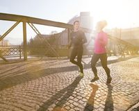 Healthy young couple jogging in the city Royalty Free Stock Photo