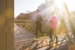 Healthy young couple jogging in the city Stock Image
