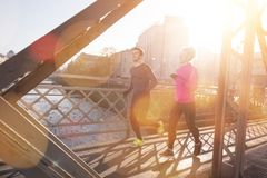 Healthy young couple jogging in the city Stock Photography