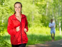 Healthy young female athlete running Royalty Free Stock Photo