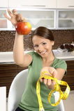 Healthy young female holding a fresh ripe apple Royalty Free Stock Image
