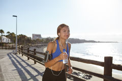 Healthy young female jogging on the beach shore Stock Photo