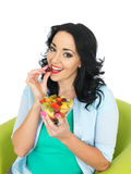 Healthy Young Fresh Faced Woman Holding a Fresh Bowl of Mixed Exotic Fruit Salad Royalty Free Stock Photography