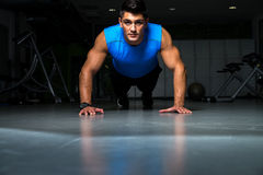Healthy young guy doing push up exercise royalty free stock photo