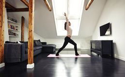 Healthy young lady going yoga workout at home Royalty Free Stock Images