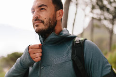 Healthy young male runner in sportswear. Portrait of healthy young man standing outdoors and looking away.  Handsome young male runner in sportswear Stock Images