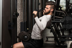 Healthy Young Man Doing Exercise For Back Stock Photo