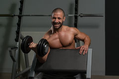 Healthy Young Man Doing Exercise For Biceps Royalty Free Stock Photo