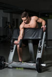 Healthy Young Man Doing Exercise For Biceps Royalty Free Stock Photos