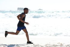 Healthy young man exercise jogging at the beach Royalty Free Stock Images
