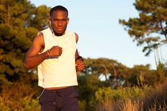 Healthy young man exercising in nature Royalty Free Stock Photos