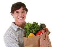 Healthy Young Man Holding Groceries Bag Royalty Free Stock Images