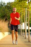 Healthy young man running outdoors Royalty Free Stock Photography