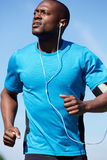 Healthy young man running outdoors Royalty Free Stock Photos