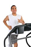 Healthy Young Man Running in Treadmill Royalty Free Stock Photography