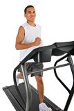 Healthy Young Man Running in Treadmill Royalty Free Stock Photos