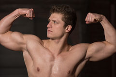 Healthy Young Man Showing His Well Trained Biceps Stock Images
