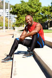 Healthy young man taking break from workout outdoors Royalty Free Stock Photo