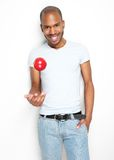 Healthy young man throwing up a red apple Stock Image