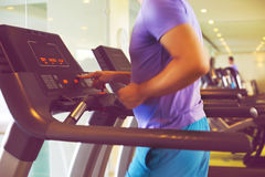 Healthy young man training on a treadmill in a sport center Royalty Free Stock Photo