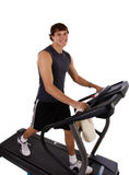 Healthy Young Man Workout on Treadmill Royalty Free Stock Photography