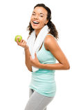 Healthy young mixed race woman holding green apple isolated on w Stock Photos