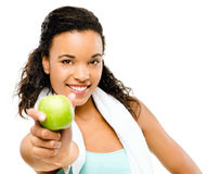 Healthy young mixed race woman holding green apple isolated on w Stock Image