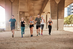Healthy young people running together in city Royalty Free Stock Image