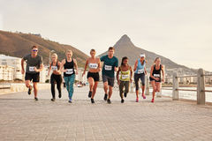 Healthy young people running together in city Stock Images