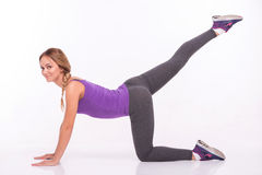 Healthy young sportswoman does the exercises Stock Images