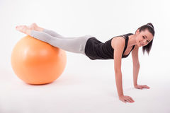Healthy young sportswoman does the exercises Royalty Free Stock Image