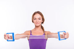 Healthy young sportswoman does the exercises Stock Image