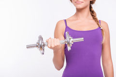 Healthy young sportswoman does the exercises Stock Photo