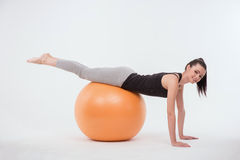 Healthy young sportswoman does the exercises Stock Photos