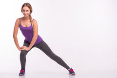 Healthy young sportswoman does the exercises Royalty Free Stock Photo
