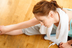 Healthy young sportswoman stretching at gym Royalty Free Stock Photography