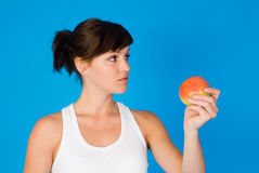 Healthy young woman with apple Stock Photography