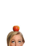 Healthy Young Woman With Apple On Her Head Royalty Free Stock Image