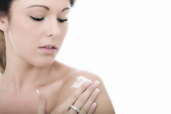 Healthy Young Woman Applying Moisturizing Cream to Shoulder Stock Photo