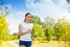 Healthy young woman in autumn park Royalty Free Stock Photography