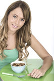 Healthy Young Woman With Breakfast Cereals Stock Photography