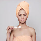 Healthy young woman. Brush your teeth in the morning Royalty Free Stock Images