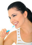 Healthy Young Woman Brushing Teeth. Attractive young woman brushing her teeth. isolated on white royalty free stock photography