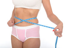 Healthy Young Woman Checking Her Weight Loss With a Tape Measure Stock Photo