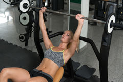 Healthy Young Woman Doing Bench Press Exercise Stock Photo