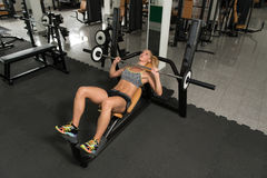 Healthy Young Woman Doing Bench Press Exercise Royalty Free Stock Photo