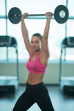 Healthy Young Woman Doing Exercise For Shoulders Royalty Free Stock Photos